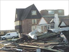 Photo taken the day after the Big Storm. A house on Jaywick sea front, with its roof in the road behind by Ray Rogers of Jaywick.