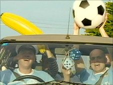City fans in car