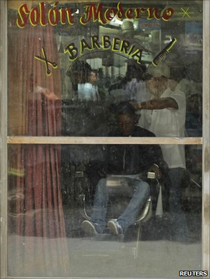 A barber works in a salon in Havana on 7 September 2010
