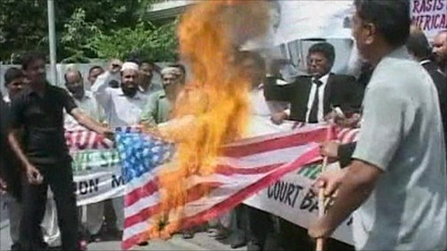 Protesters burn the American flag