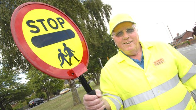 A lollipop man with a stick fitted with a video camera
