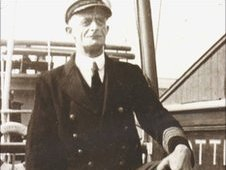 Black and white photo of ships captain