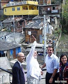 President Lula (waving) at the Dona Marta slum in Rio de Janeiro