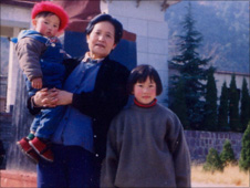 Ayi Jihu (right) as a child