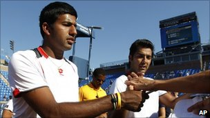 Rohan Bopanna of India, left, and partner Aisam-Ul-Haq Qureshi of Pakistan sign autographs after winning their semifinals doubles match during the US Open tennis tournament in New York, Wednesday, 8 September 2010