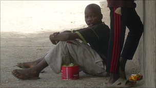 A Daara student begs on the streets of Dakar
