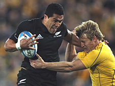 Mils Muliaina holds off Lachie Turner's challenge