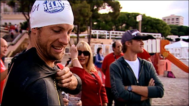 Jenson Button suits up for the team triathlon