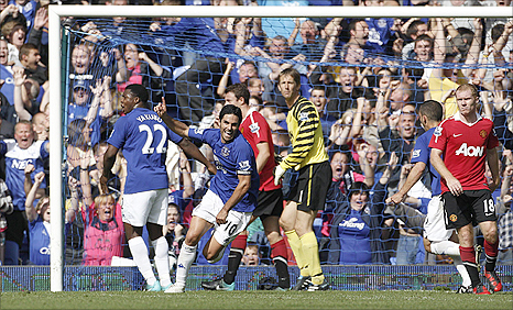 Everton's Mikel Arteta (centre) wheels away in celebration after his dramatic equaliser against Man Utd