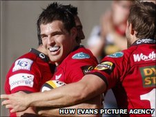 Scarlets wing Sean Lamont is congratulated after his late winner