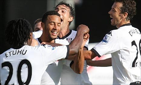 Fulham's players mob Moussa Dembele after his injury-time winner on Saturday