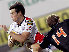 Ulster's Adam D'Arcy in possession against Giulio Toniolatti of Aironi