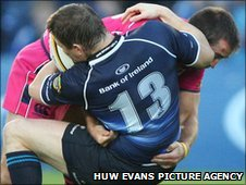 Blues' Dafydd Hewitt collides with rival Leinster centre Brian O'Driscoll