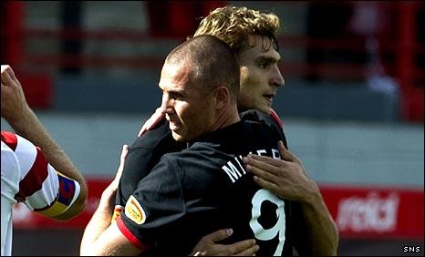 Kenny Miller celebrates his goal against Hamilton with Nikica Jelavic