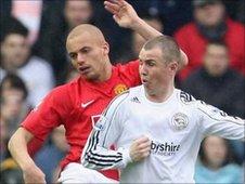 Man Utd's Wes Brown tackles Kenny Miller