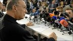 Archbishop Andre-Joseph Leonard listens to questions during a press conference in Brussels