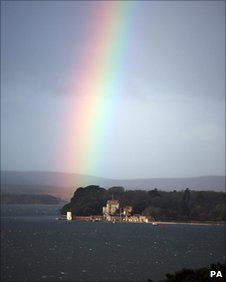 Rainbow over Brownsea Castle, Poole - Martin Keene/PA