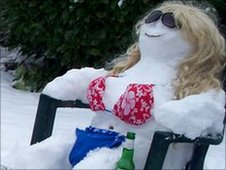 Snowmen relaxing on holiday