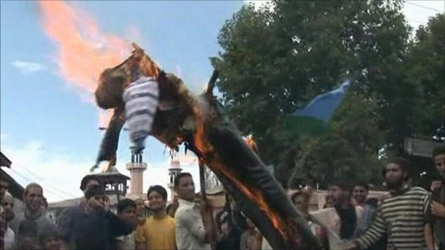 Protesters burning an effigy of President Barack Obama