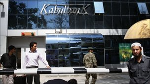 Men walk outside Kabul Bank