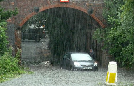 Car in floodwater. Photo by Harry Taylor