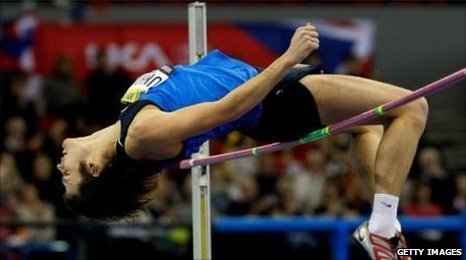 Ivan Ukhov clears the high jump bar.