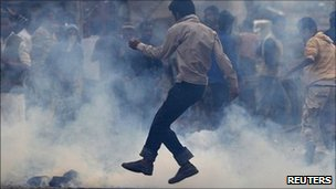 A Kashmiri protester runs for cover during an anti-India protest in Srinagar on Tuesday 14 September 2010