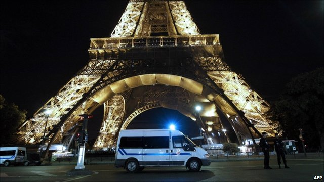 French police at the base of the Eiffel Tower