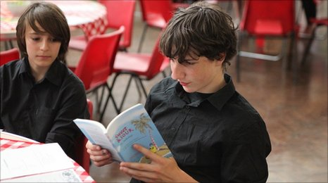 First Story student reading his school's anthology