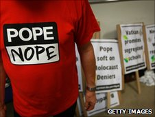 Placards made by members of the Protest The Pope Campaign are preparied at The Humanist Society