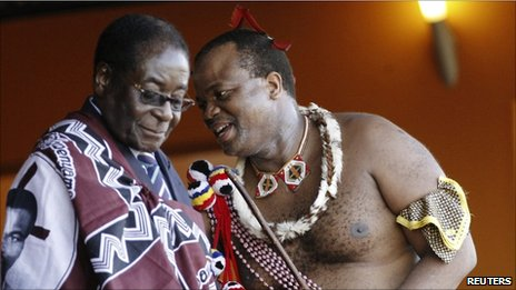 Zimbabwe's President Robert Mugabe (L) chats with King Mswati III during the annual Reed Dance at Ludzidzini, the royal palace in Swaziland August 30, 2010.