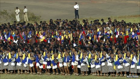 A policeman and boy scouts keep watch as maidens take part in the annual Reed Dance at Ludzidzini, the royal palace in Swaziland August 30, 2010