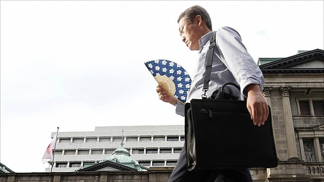 Man walks past Bank of Japan