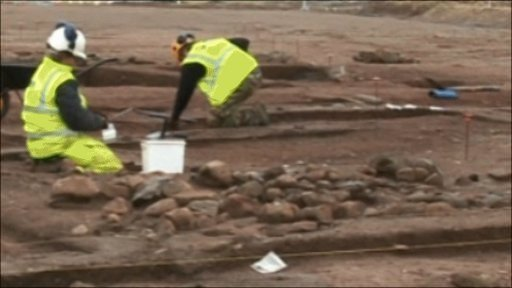 Archaeologists excavating a bronze age site at Ronaldsway Airport