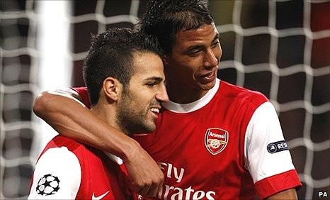 Arsenal's Cesc Fabregas and Marouane Chamakh celebrate