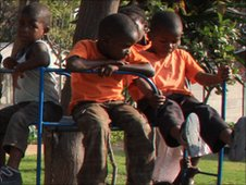 Orphans playing on a climbing frame