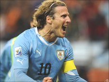 Diego Forlan celebrates after scoring for Uruguay at the World Cup