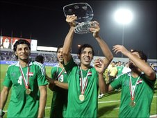 Iraqi players celebrate winning the United Arab Emirates International Cup, November 2009