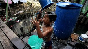 Child washes in a slum in Manokwari