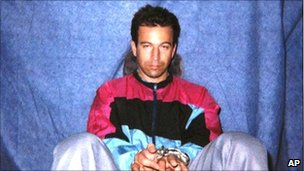 Daniel Pearl in shackles after his kidnapping in Karachi