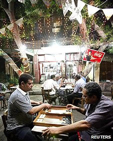 Men playing backgammon in a Cairo coffee shop
