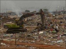 Bulldozer clearing Roque Santerio market