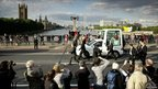 The popemobile crosses Lambeth Bridge