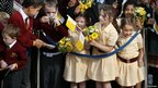 Schoolchildren wait to see the Pope 