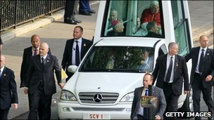 Pope Benedict XVI surrounded by security guards