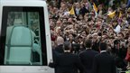 Pope Benedict XVI is driven by popemobile on the Mall