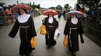 Three nuns wait for the Pope