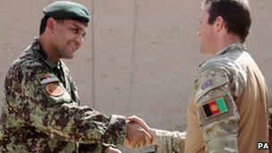Major Richard Forsyth saying goodbye to the man he has advised for the past six months in Sangin,Captain Nadri, of the Afghan National Army
