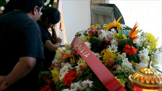 Relatives at the funeral of a photo journalist who worked for El Diario newspaper in Ciudad Juarez