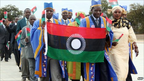 People parade with the Malawi's new flag, on 7 August, 2010 in Blantyre